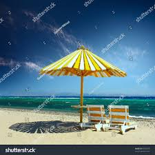 Two Beach Chairs Wooden Umbrella On A Beach And Two Chairs Stock Photo 59782375
