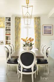 415 best dining spaces images on pinterest dining room design contemporary cream dining room with beadboard ceiling
