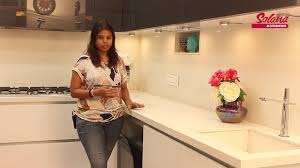 lacquered glass kitchen cabinets lacquered glass finish l shape modular kitchen by solana kitchens
