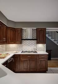 white kitchen cabinets with hexagon backsplash white backsplash with hexagon feature pewabic pottery