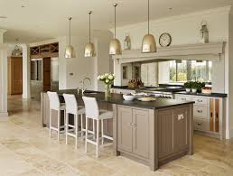 kitchen white bar stool grey countertops hanging lamps brown