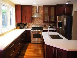 Brands Of Kitchen Cabinets by Brown Cabinets And Black Countertops Fancy Home Design