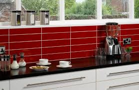 white cabinetry black gloss bench top red tiling splash back