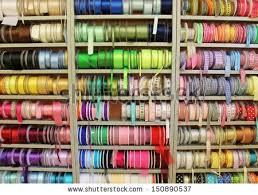 ribbon shop haberdashery haberdasher ribbon reels rolls rows stock photo