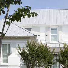 ueco white house with gray metal roof and gray shutters