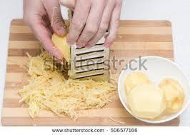 potato pancake grater mans grater grate potatoes on stock photo 506577166