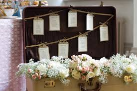 vintage suitcase filled with flowers for wedding style seating