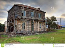 old abandoned two storey wooden farmhouse stock photo image
