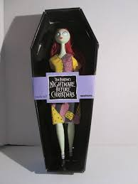 sally from the nightmare before doll in coffin burton