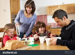 family eating breakfast together kitchen stock photo 114546322