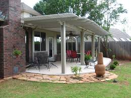 Simple Covered Patio Designs by This Rustic Styled Patio And Home Features Large Natural Wood