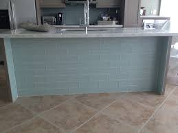 kitchen tiled walls ideas beachy kitchen with onyx countertops and glass tile at front