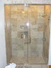 bathroom white corner tub and shower using glass door with combo