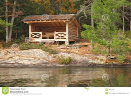 rustic cabin by a lake stock images image 6800764