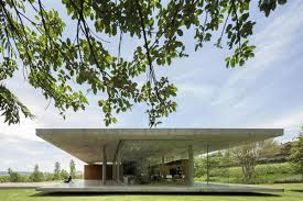 one story house sandwiched between two concrete slabs concrete