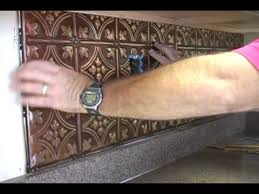 How To Put Up Tin Ceiling Tiles by Installing A Kitchen Backsplash Youtube