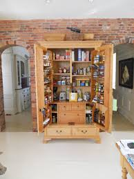 Antique Spice Rack Entrancing Cabinet Pantry Storage Wood In Front Of Faux Brick Wall
