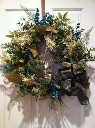 hand made vintage birdcage with floral arrangement by design