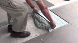 how to lay large format tiles without a self levelling