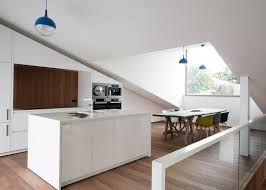 a sloping green roof hides the split level interior of belgium u0027s