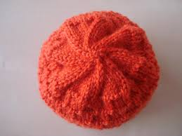 hand knit baby hat in a beautiful rusty orange colour