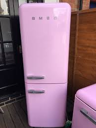 1950s style pink smeg fridge freezer in cheltenham