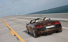 Audi R8 Gt Spyder - audi r8 gt spyder driving on a concrete road by the sea