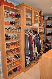 Glass Front Living Room Cabinets Floor To Ceiling Slanted Shelves For Shoes Plus Some Hanging