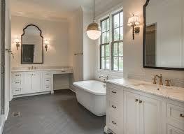 White Bathroom With Dark Gray Herringbone Tile Floor - White cabinets dark floor bathroom