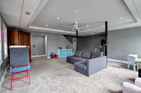 contemporary basement with carpet u0026 ceiling fan in marietta ga