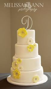 wedding cake top yellow and white wedding cake top and bottom tiers were lemon with