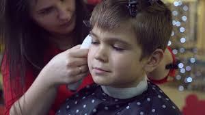 female haircutting videos clipper barber cutting hair caucasian little boy brunette hairdresser