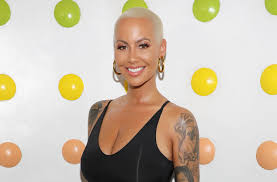 amber rose covers up her wiz khalifa tattoo with another man u0027s