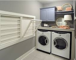 grey laundry room paint color with wall shelves for storage over