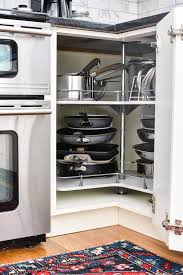 how to organize pots and pans in a cupboard organizing pots and pans in a corner cabinet smallish home
