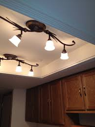 Kitchen Track Lighting by Convert That Ugly Recessed Fluorescent Ceiling Lighting In Your