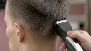 female haircutting videos clipper close up of men s haircut with clipper in the barber shop macro