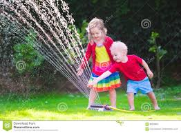 kids playing with garden sprinkler stock photo image 69258957