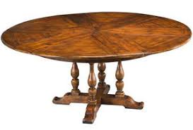 solid walnut dining table large round solid walnut dining table with hidden leaves 64 to 84