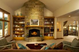 living room wall with stone fireplace and brown wooden