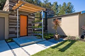 orange front door landscape contemporary with wood panel exterior