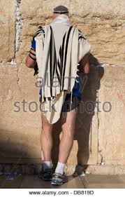 prayer shawls from israel with prayer shawl praying by city walls near zion gate