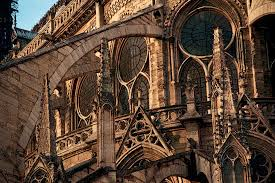 flying buttress flying buttresses behind notre dame cathedral in the winter