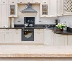 Kitchen Interior Designs Wooden Textured Table Over Blurred Kitchen Interior Background
