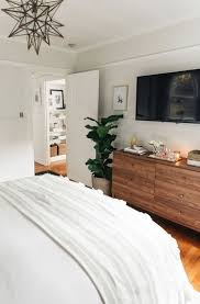 bedroom minimalist interior design modern armchair wooden bed