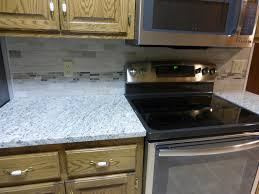 kitchen cooktop and dallas white granite countertops with mosaic