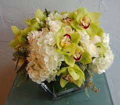 White Roses In A Vase Orchids Hydrangeas In A Square Glass Vase