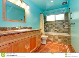 bathroom in bright blue color with green tile wall trim stock