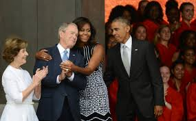 george w bush hopes to partner with pal michelle obama to help