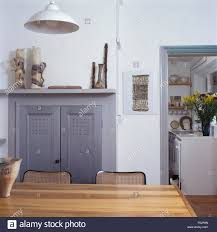 gray wooden doors on cupboard in a fireplace in a white dining